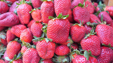 A pile of organic fresh strawberry close up Footage