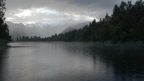 Depressed cloudscape and strong rain over the Lake Matheson Live Action