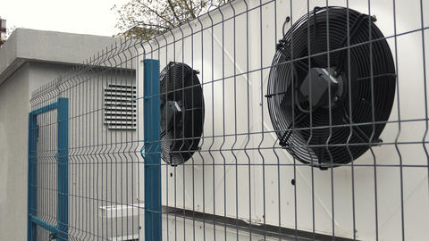 Building ventilation system HVAC behind the fence Footage