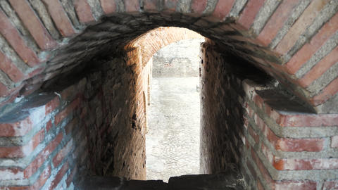 Old passage between red brick walls Footage