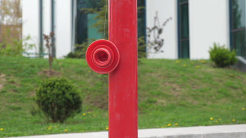 Red hydrant in front of the office building Footage