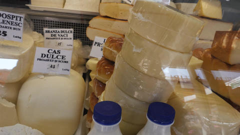 Selling cheese and yellow cheese at market Footage