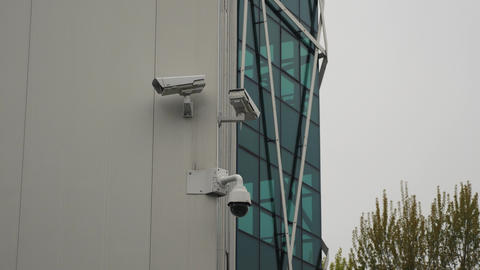 Surveillance cameras dome and fixed on the office building Footage