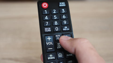 Using the tv remote close up Live Action