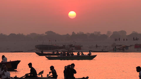 India, Varanasi, 14 Mar 2019 - Silhouettes of boats and unidentified people Footage
