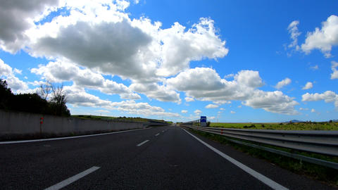 Hyper lapse driving in a beautiful cloudy and sunny day Live Action
