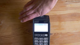 Closeup shoot of a payment terminal being used for payment by an app on the Footage