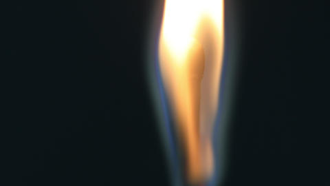 A lit wooden match burning down slowly Stock Video Footage
