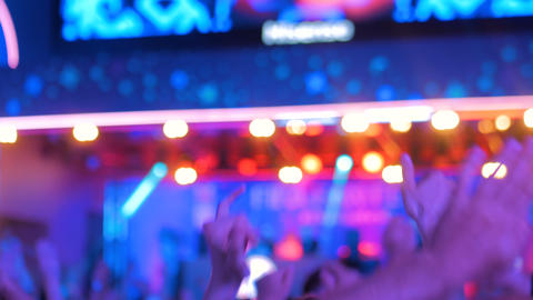 People partying at night electronic music concert in front of the stage Footage
