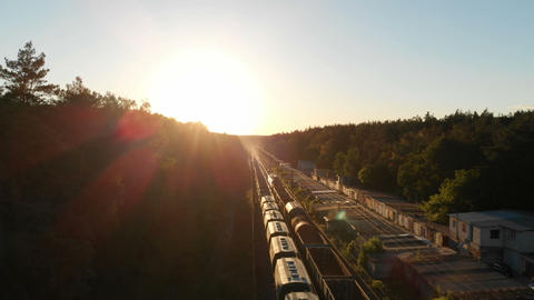Two trains transporting cargo wagons moving in opposite directions in slo-mo Footage