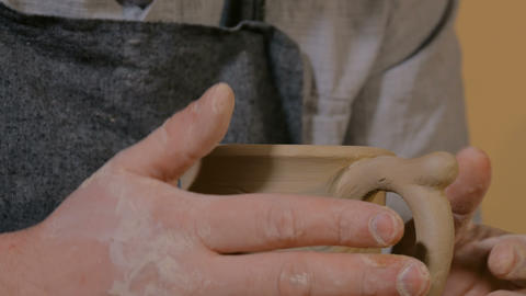 Professional male potter working in workshop, studio Footage