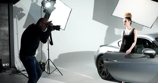 Photographer Shooting A Fashion Model In The Studio Footage