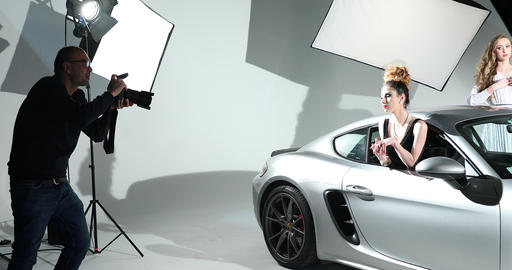 Photographer Shooting A Fashion Model With Sports Car Footage