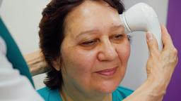 Hardware facial massage for senior woman Live Action