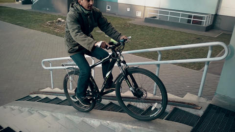 man doing trick on bicycle, ride inside the the entrance Footage