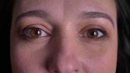 Close-up eye-portrait of middle-aged woman watching with extremely happy smile Footage