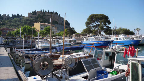 Panning harbour Cassis showing boats town people provence france Footage
