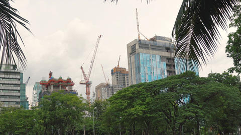 Construction of skyscrapers in a busy business district. Construction cranes are Footage