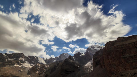 Glitch effect. Mountain valley in the clouds. TimeLapse. Clouds blurred. Tajikistan Live Action