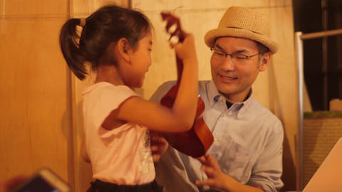Musical instrument / happy parent and child Live Action