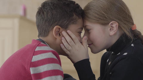 Portrait of adorable african american boy and pretty blond caucasian girl Footage