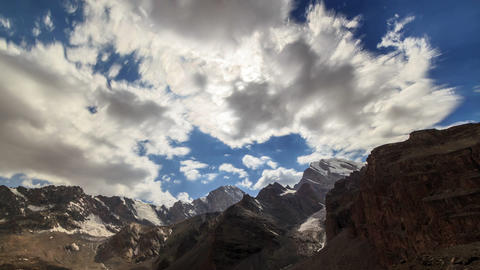 Glitch effect. Mountain valley in the clouds. TimeLapse. Clouds blurred. Tajikistan Footage
