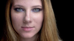 Closeup shoot of young beautiful female face with stunning makeup with Footage