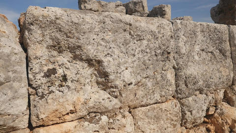 Stone background. An old stone texture wall in the ancient greek city Lyrboton Footage