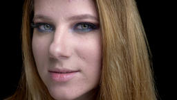 Closeup shoot of young beautiful female face smiling with beautiful makeup with Footage