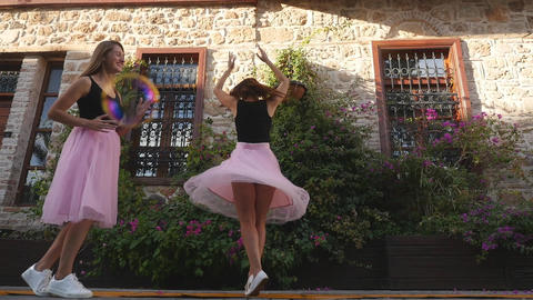 Fashion lifestyle two young women in tulle skirt funnily dancing Footage