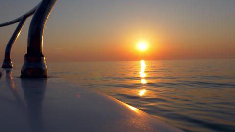 Gunwale POV - Floating on the water at sunset Live Action
