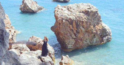 Beautiful woman with black scarf in elegant black dress Footage