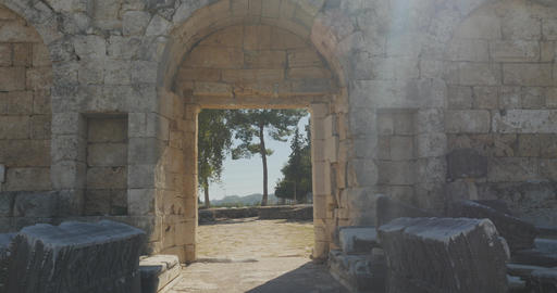 Walking through ancient arch in the wall in Ancient city Perge, open air antique Footage