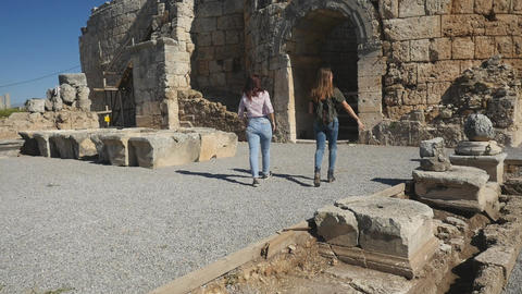 Walking with map in Ancient city Perge, open air antique historical museum Footage