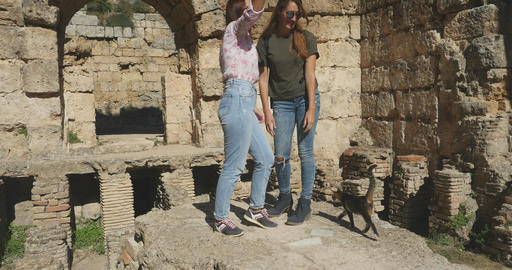 Taking pictures in Ancient city Perge, open air antique historical museum Live Action