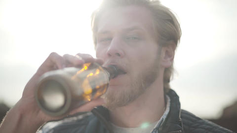 Close up portrait handsome bearded man drinking beer and enjoying beverage Live Action