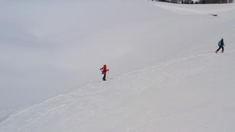 Ski touring and splitboarding concept. Group tourist people walking on ski in snowy mountain while Footage