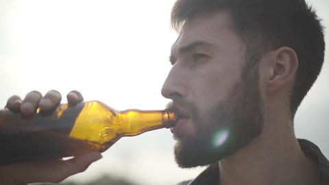 Portrait attractive bearded man drinking beer and enjoying beverage outdoors Live Action