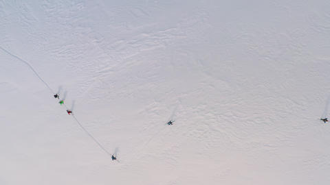 Top view from drone tourist people walking on ski while at winter day. Aerial view sport people Footage