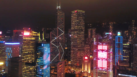 Aerial view of Hong Kong Downtown and Victoria Harbour. Financial district, business centers in Live Action