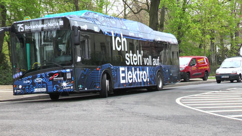 Bus stop and electrically powered bus of line 75 of RMV Footage