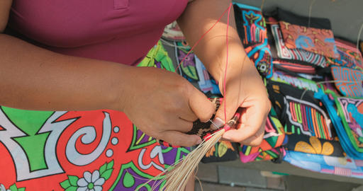 Hands Using Needle To Make Indigenous Souvenirs In Panama Market Footage