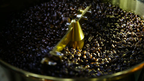 Modern roasted coffee beans in modern coffee roasters Footage