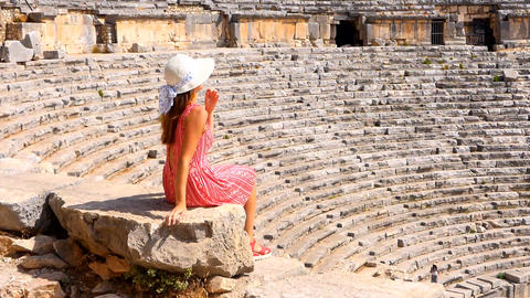 Pretty woman watching the ruins of Antique Theater Footage