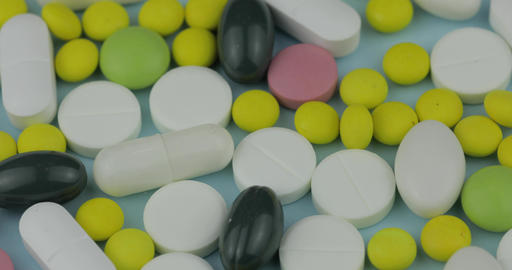 Many different spinning pills and drugs. Medicine, pills and tablets turning Footage