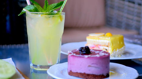 Homemade lemonade and fruity cakes Footage