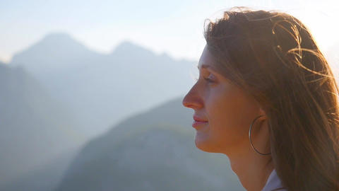 Portrait of beautiful woman standing againt sunlights Footage