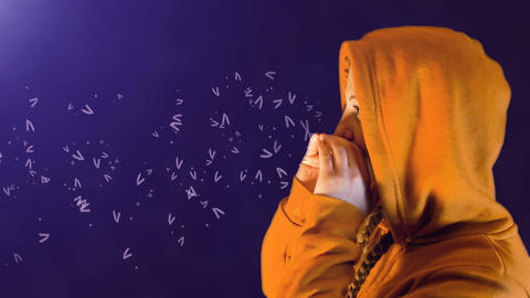 teenage girl, with orange hoodie and sweatshirt, screams and words come out Archivo
