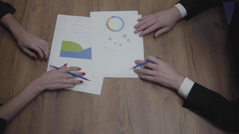 Above view shot of graphic data templates table with unrecognizable business Footage