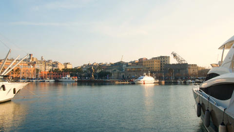 sunset view of the old port of Genoa, the birthplace of Christopher Columbus Live Action
